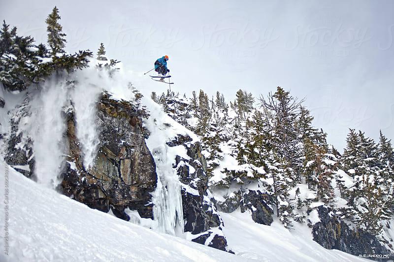 Skier jumping cliff in Whistler backcountry. Extreme ski  by Alejandro Moreno de Carlos for Stocksy United