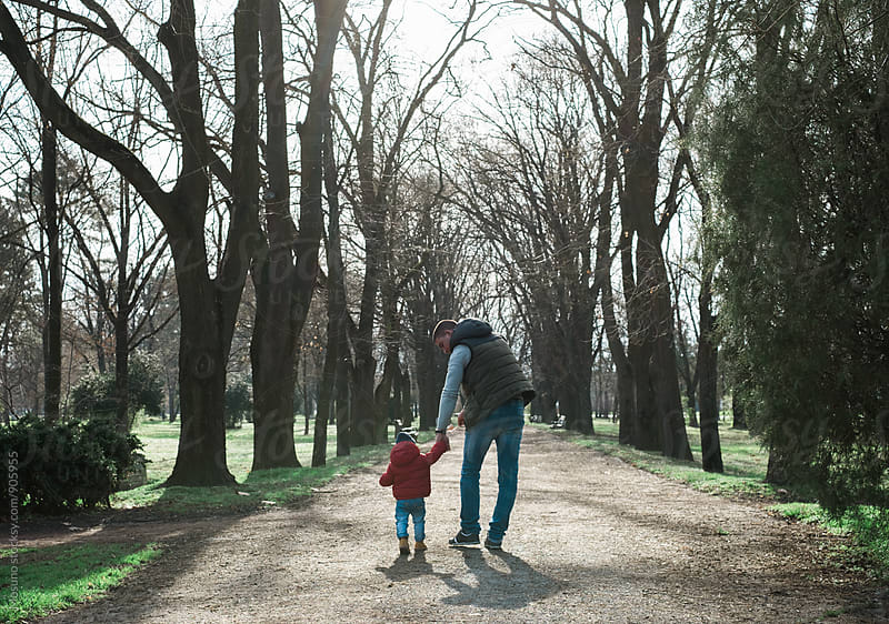 Little Boy with His Uncle in the Park by Mosuno for Stocksy United