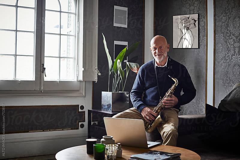 Senior Man With Saxophone In Living Room by ALTO IMAGES for Stocksy United