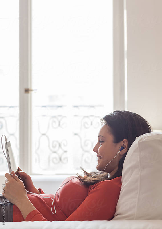 Young Woman Using Technology at Home by Mosuno for Stocksy United