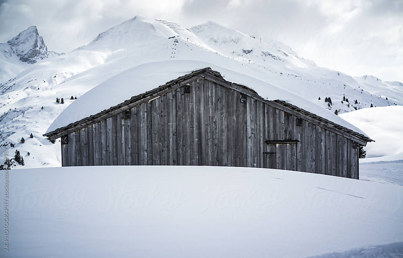 Snow covered hut by J.R. PHOTOGRAPHY for Stocksy United