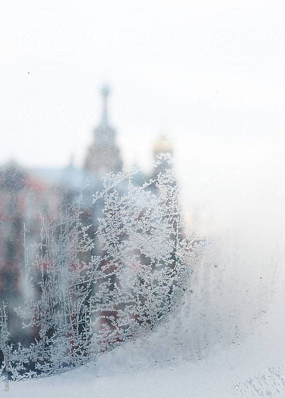 Russian orthodox church through tracery made by frost on a windowpane  by Lyuba Burakova for Stocksy United