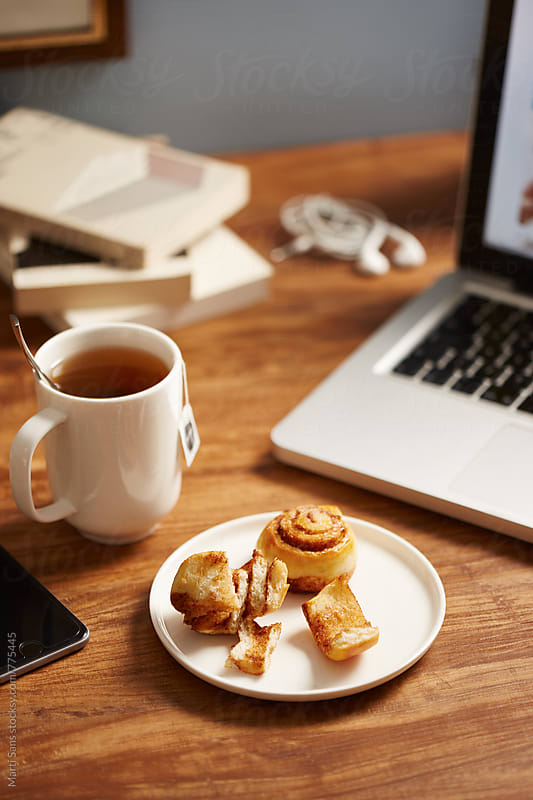 Breakfast while working by Martí Sans for Stocksy United