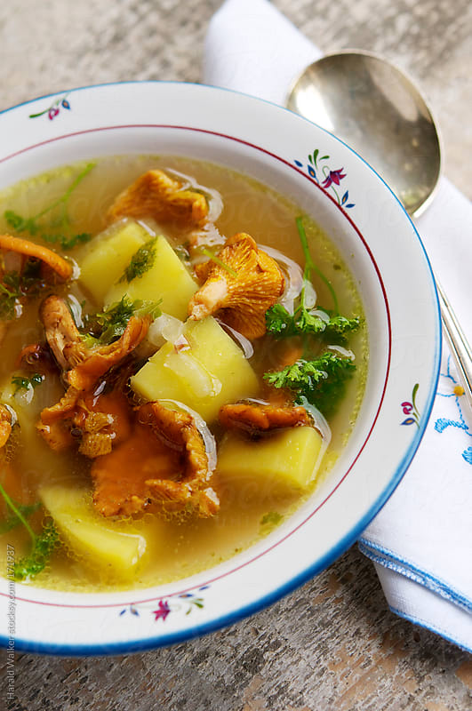 Vegetable Bouillon Soup with Chanterelle Mushrooms by Harald Walker for Stocksy United