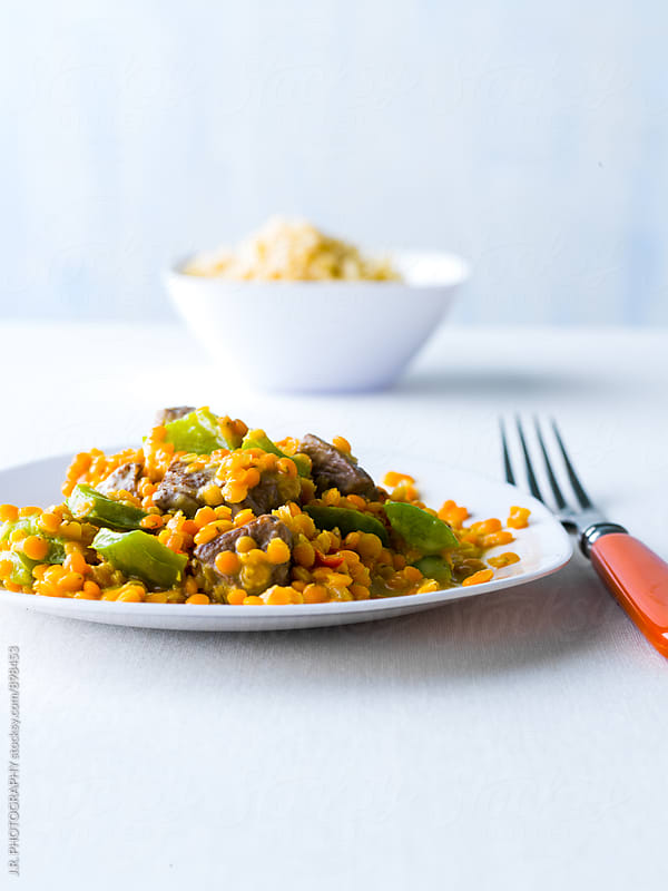 Lentil dal with lamb by J.R. PHOTOGRAPHY for Stocksy United