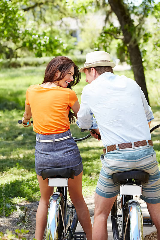Couple riding a bike together in the park by Trinette Reed for Stocksy United