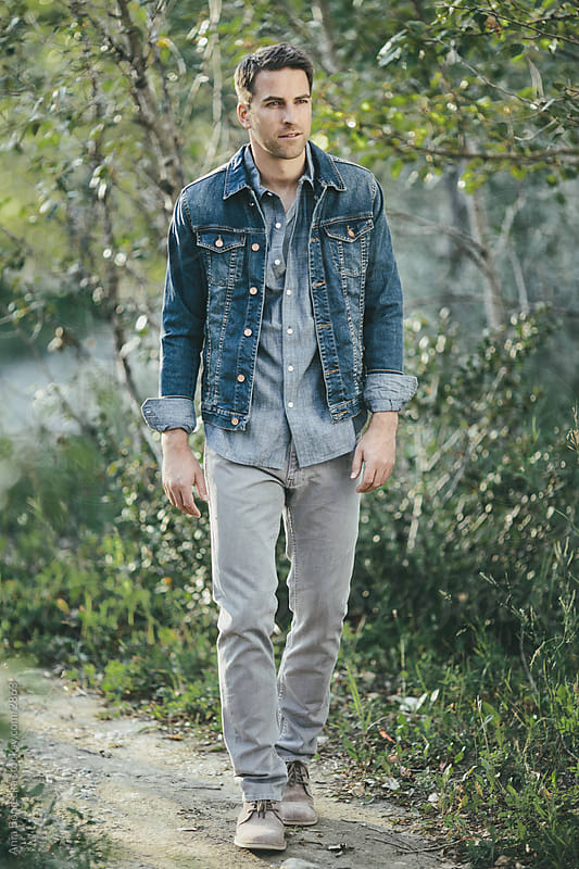 Walking outdoors in denim by Ania Boniecka for Stocksy United