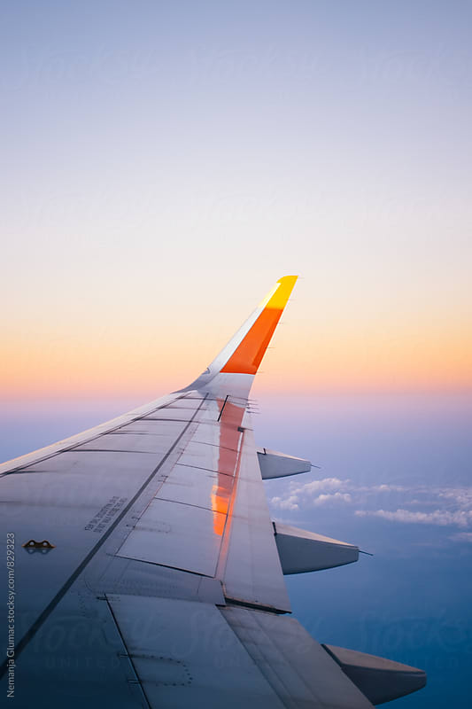Calming Sunrise Sky Through the Airplane Window by Nemanja Glumac for Stocksy United