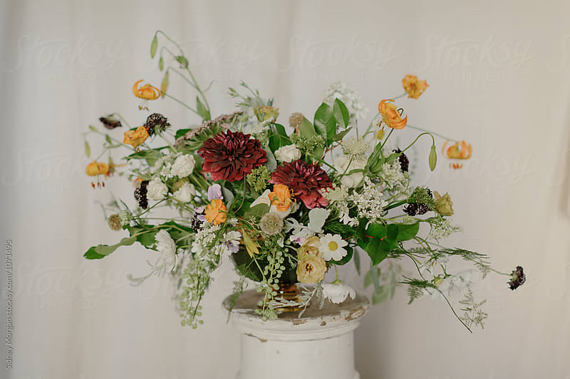 Wedding Flowers in Front of White Curtain by Sidney Morgan for Stocksy United