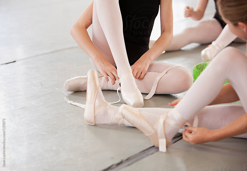 Ballet: Students Putting Pointe Shoes On Feet by Sean Locke for Stocksy United