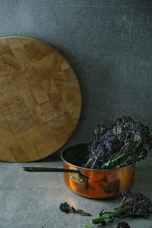 Purple sprouting broccoli in a copper pan. by Darren Muir for Stocksy United