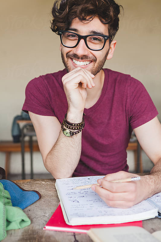 Happy Young Man Studying at College by Giorgio Magini for Stocksy United