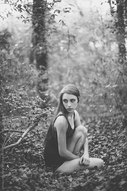 Young woman sitting in the forest by Aleksandra Kovac for Stocksy United