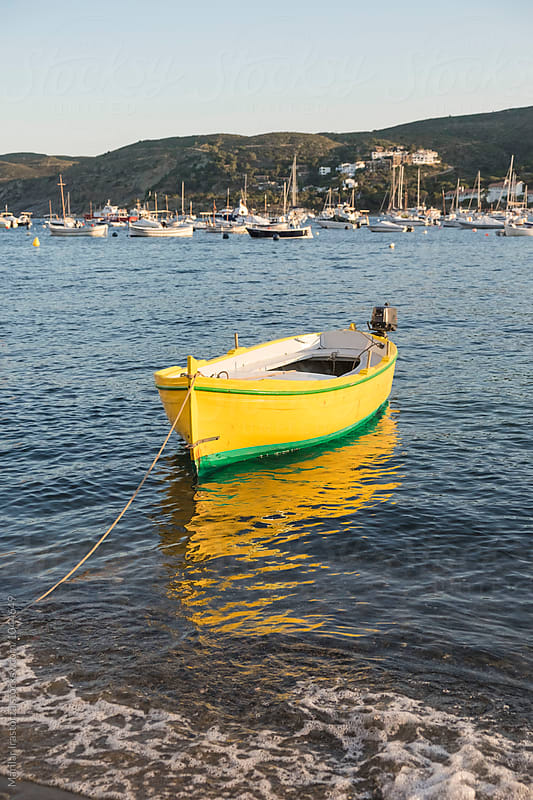 Yellow boat by Marilar Irastorza for Stocksy United