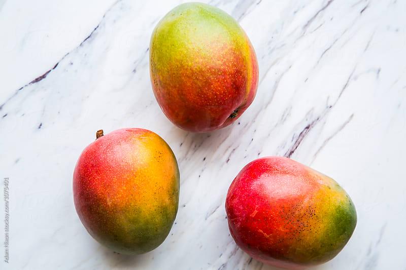 Fresh ripe mangos by Adam Nixon for Stocksy United