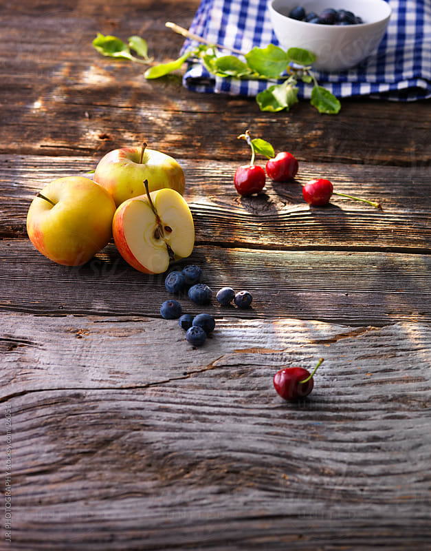 Apples, cherries, blueberries by J.R. PHOTOGRAPHY for Stocksy United