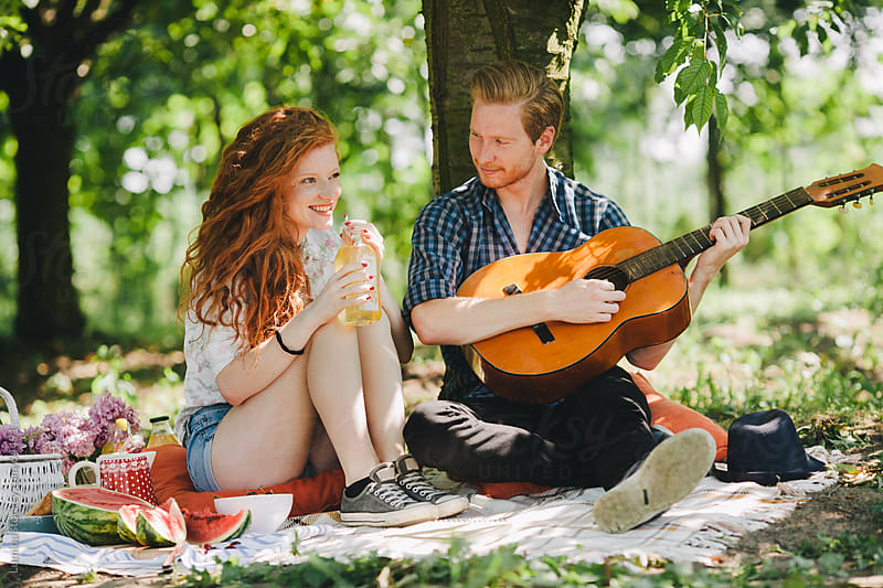 Man Playing the Guitar on a Picnic by Lumina for Stocksy United