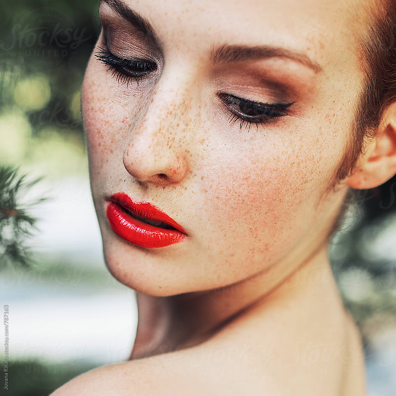 Young woman with freckles by Jovana Rikalo for Stocksy United