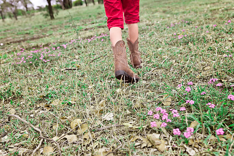 cowgirl on the farm by Gillian Vann for Stocksy United
