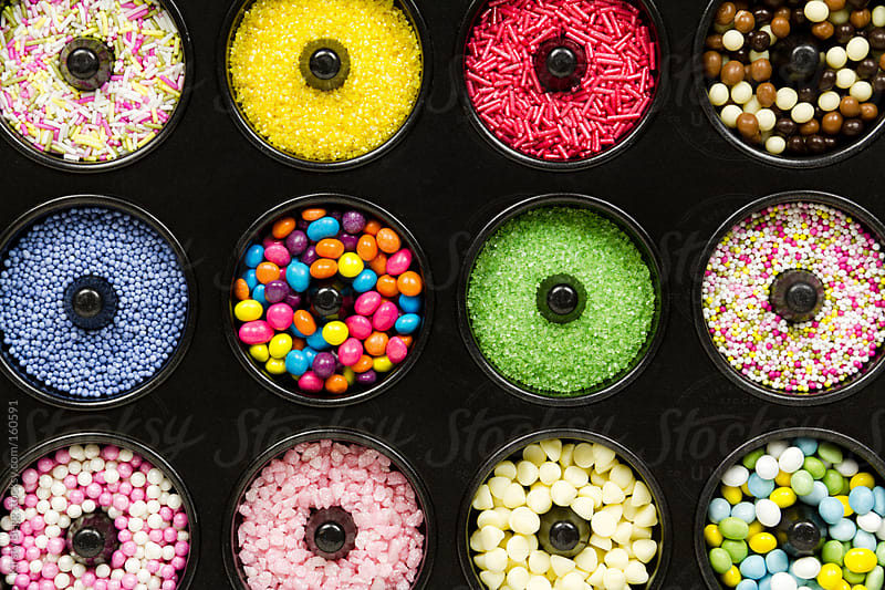 Doughnut pan filled with sprinkles by Kirsty Begg for Stocksy United