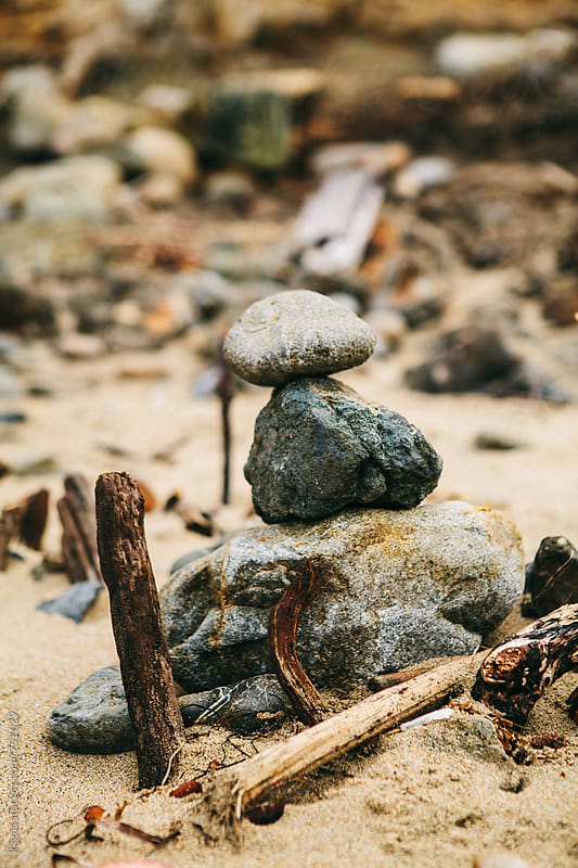 Stack of zen stones with driftwood on beach by kkgas for Stocksy United