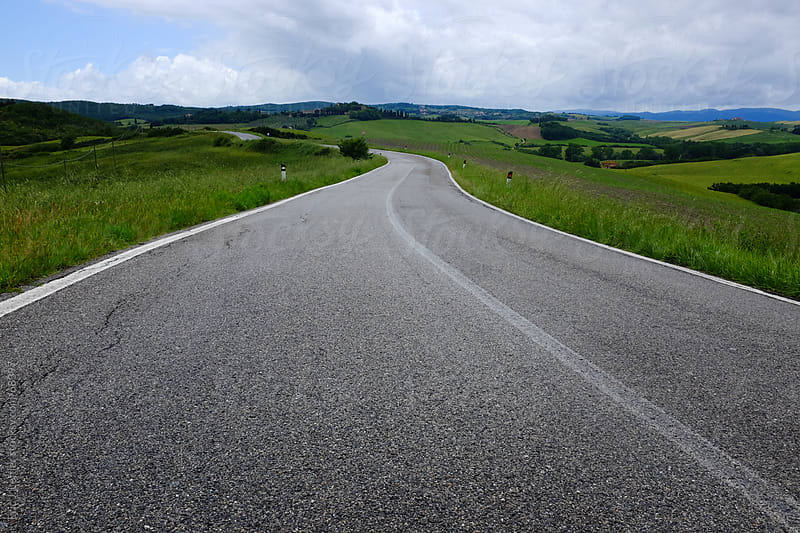 Curving Road in Tuscany by Eric James Leffler for Stocksy United
