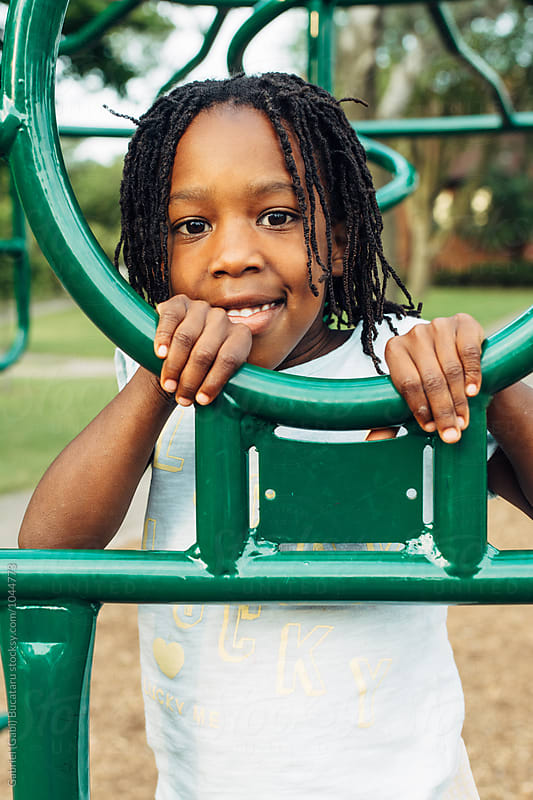 Smiling African American girl in a park by Gabriel (Gabi) Bucataru for Stocksy United