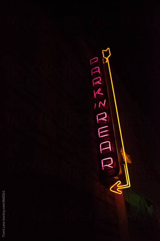 Neon park in rear signboard of bar at night by Trent Lanz for Stocksy United