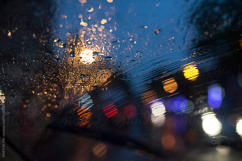 obscure street lights through wind screen in rain by PARTHA PAL for Stocksy United