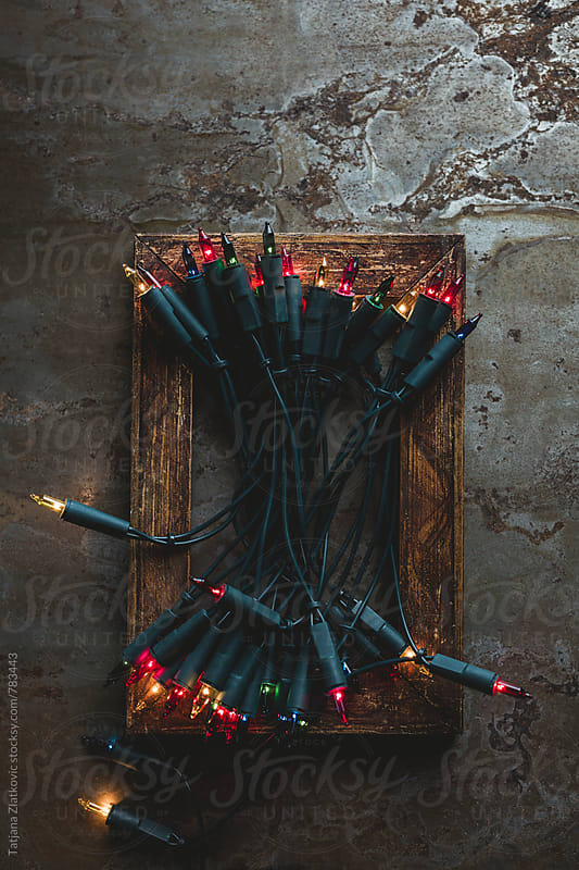 Wooden frame with christmas lights by Tatjana Ristanic for Stocksy United
