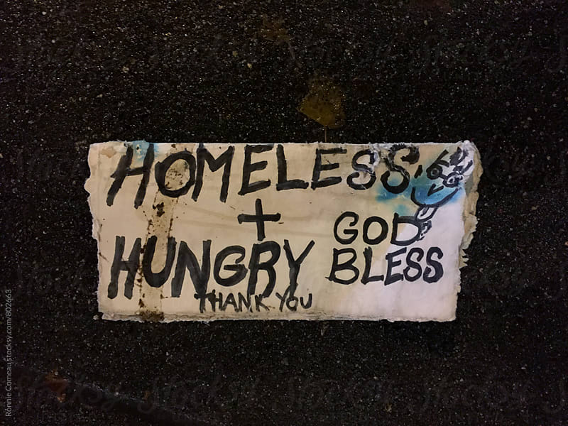 Homeless and Hungry Sign On The Ground by Ronnie Comeau for Stocksy United