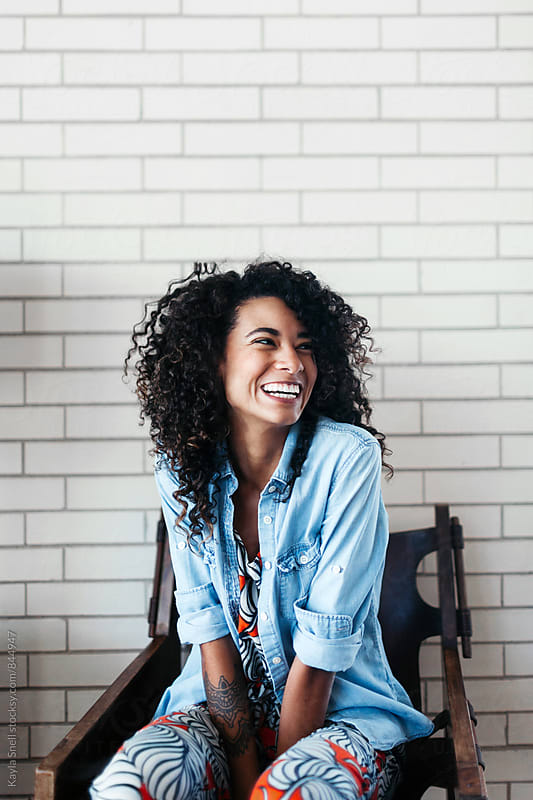 Young woman laughing by Kayla Snell for Stocksy United