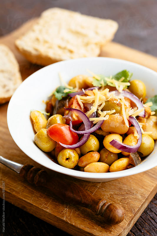 Mixed Bean Bowl with Eggplant and Green Olives by Harald Walker for Stocksy United