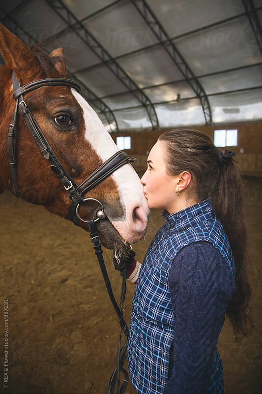 Close-up of female rider kissing her horse by Danil Nevsky for Stocksy United