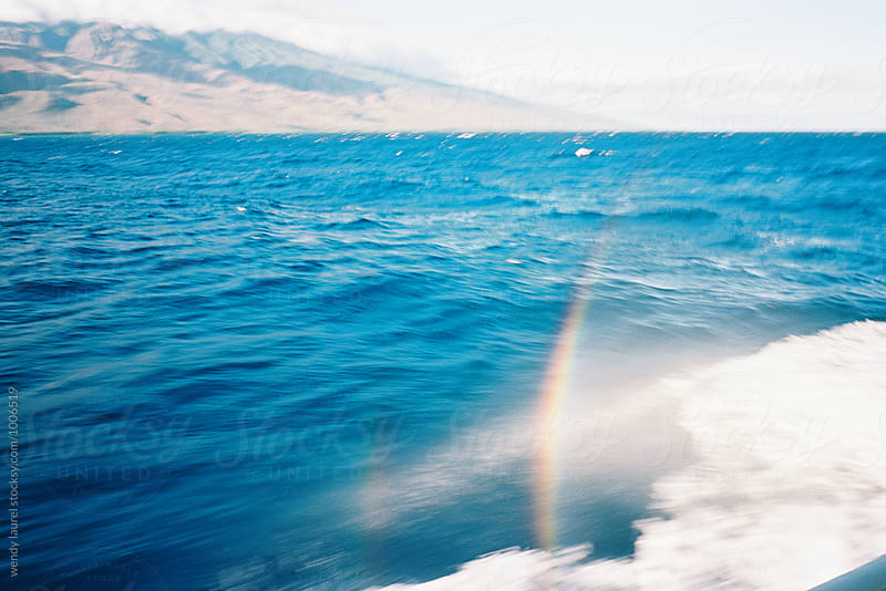rainbow in sea spray off boat off molokai by wendy laurel for Stocksy United