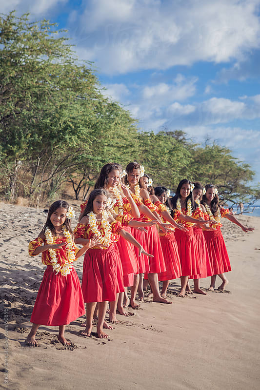 Group of Traditional Hawaiian Hula Dancers Lined Up on the Beach by Shelly Perry for Stocksy United