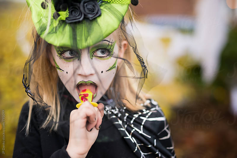 Little Girl Dressed Up In Witch Costume For Halloween With Elaborate Make Up by JP Danko for Stocksy United