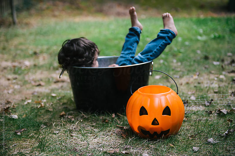 toddler lounges in Halloween decorations by Tara Romasanta for Stocksy United