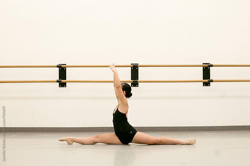 Graceful dancer doing splits  by Jennifer Brister for Stocksy United