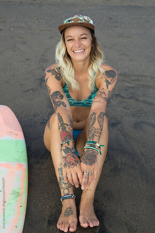 Portrait of a beautiful tattooed surfer woman by Jovo Jovanovic for Stocksy United