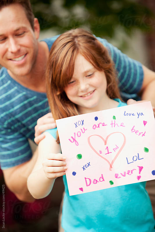 Father: Girl Showing Father's Day Card by Sean Locke for Stocksy United