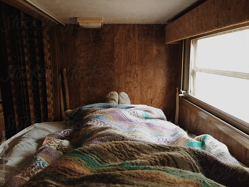 Tight sleeping quarters in trailer bunk bed by Carey Shaw for Stocksy United