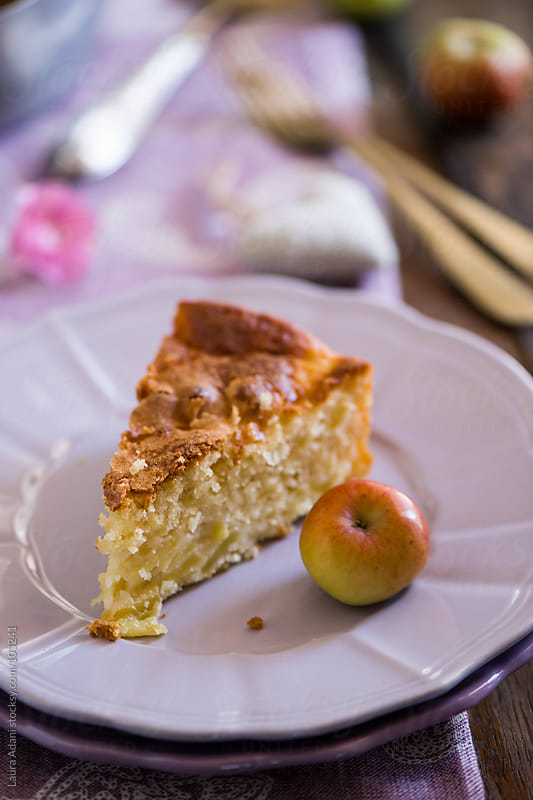 a slice of apple cake  on a plate by Laura Adani for Stocksy United