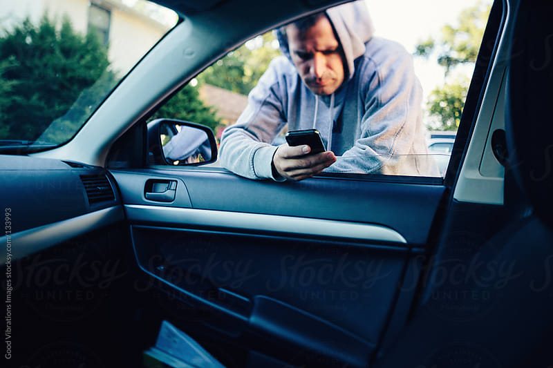 Man in the Car with Smartphone by Good Vibrations Images for Stocksy United