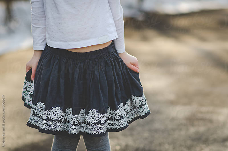 Young girl wearing embroidered skirt by Lindsay Crandall for Stocksy United