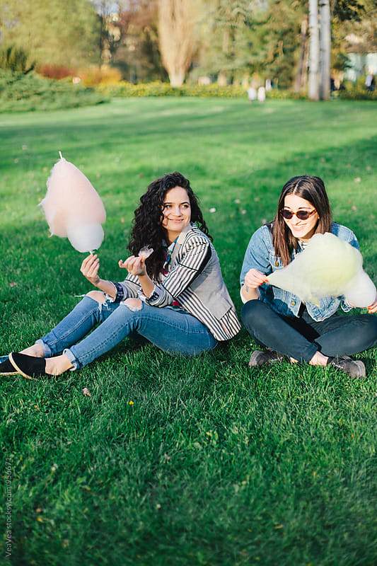 Two female friends having a good time in a park by Marija Mandic for Stocksy United