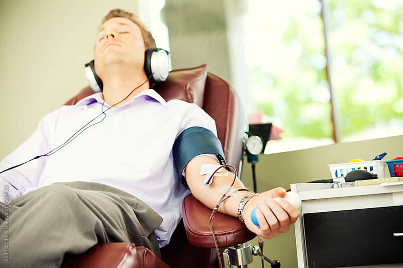 Blood Bank: Man Listens to Music to Relax by Sean Locke for Stocksy United