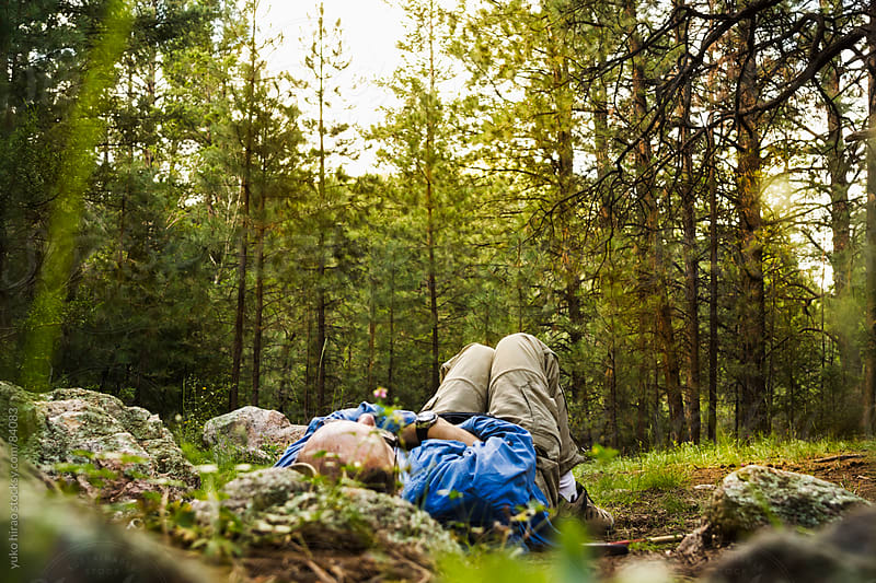 A man sleeping in forest after hiking by yuko hirao for Stocksy United