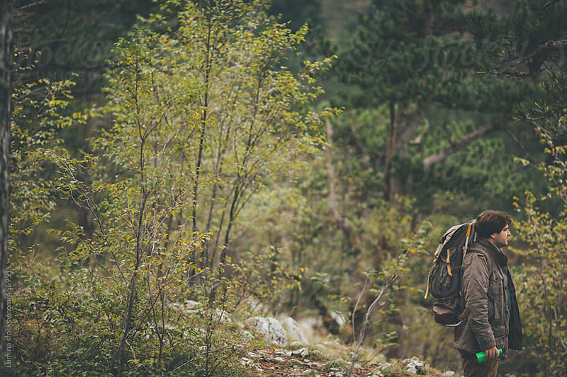Smiling Caucasian Hiker Standing in Nature by Lumina for Stocksy United