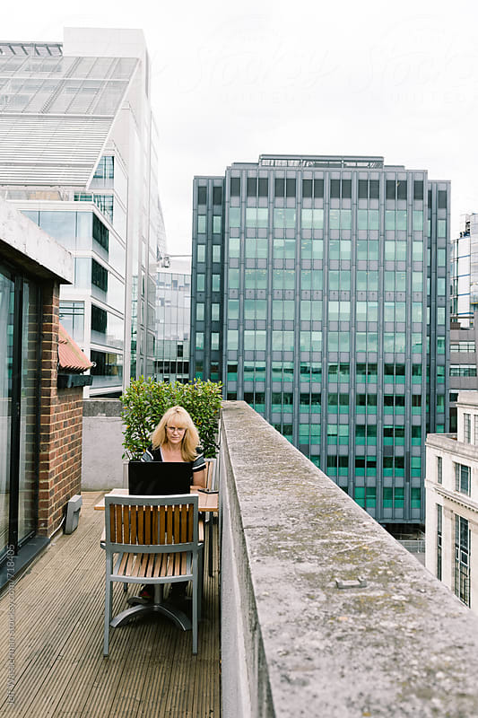 Business Woman on Computer on Terrace by Jeff Wasserman for Stocksy United